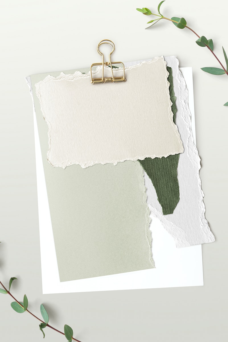 Blank torn green paper templates set with a paperclip