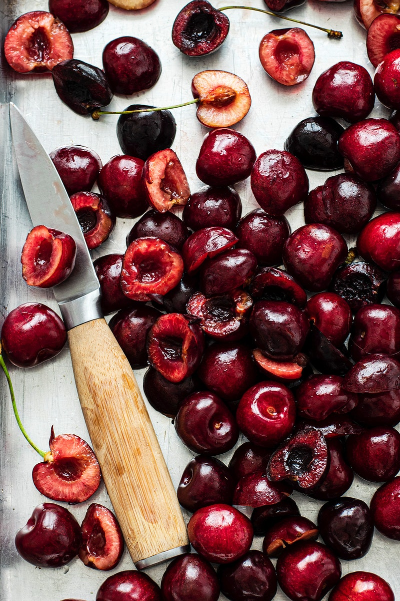 Freshly baked cherries on a baking tray