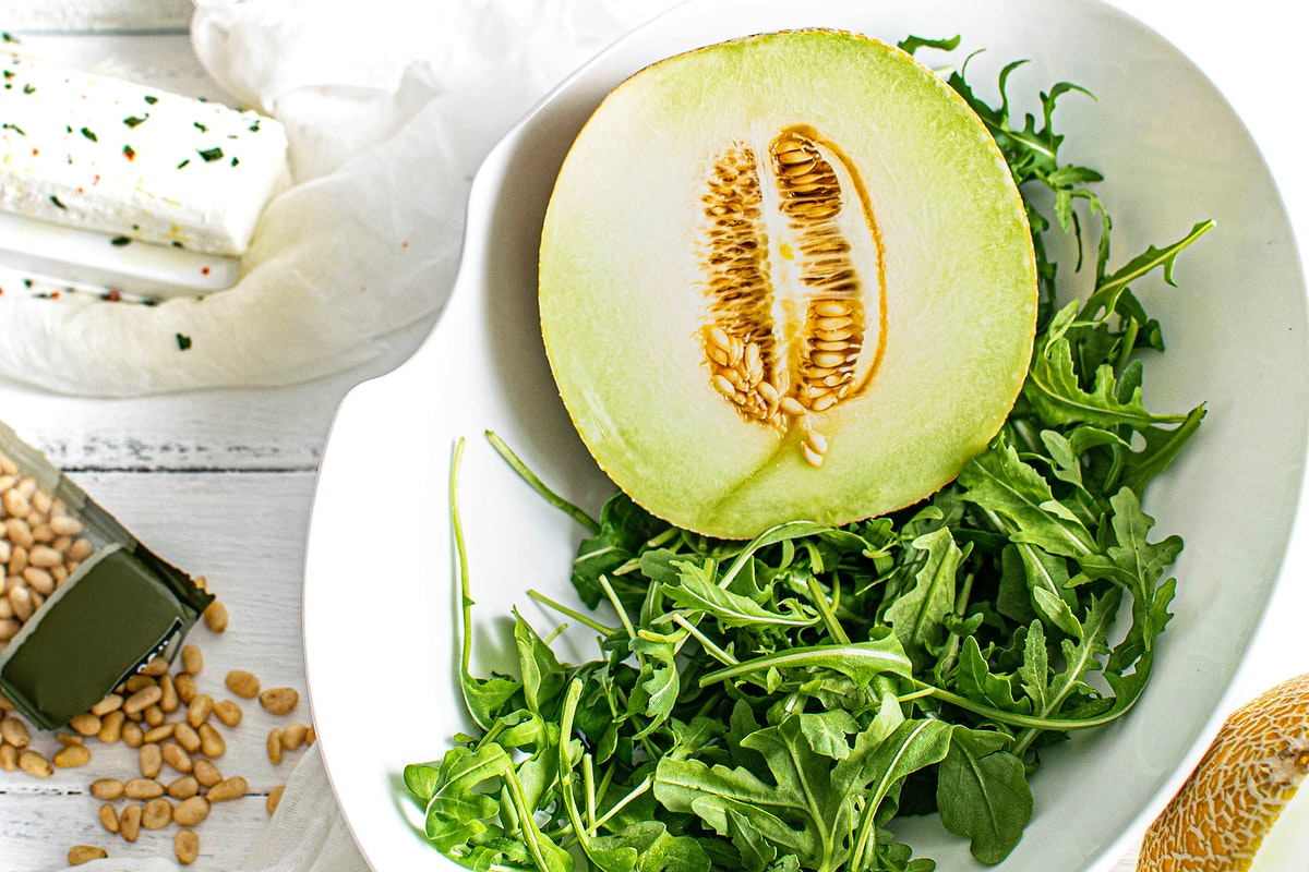 Melon with rocket salad in a bowl