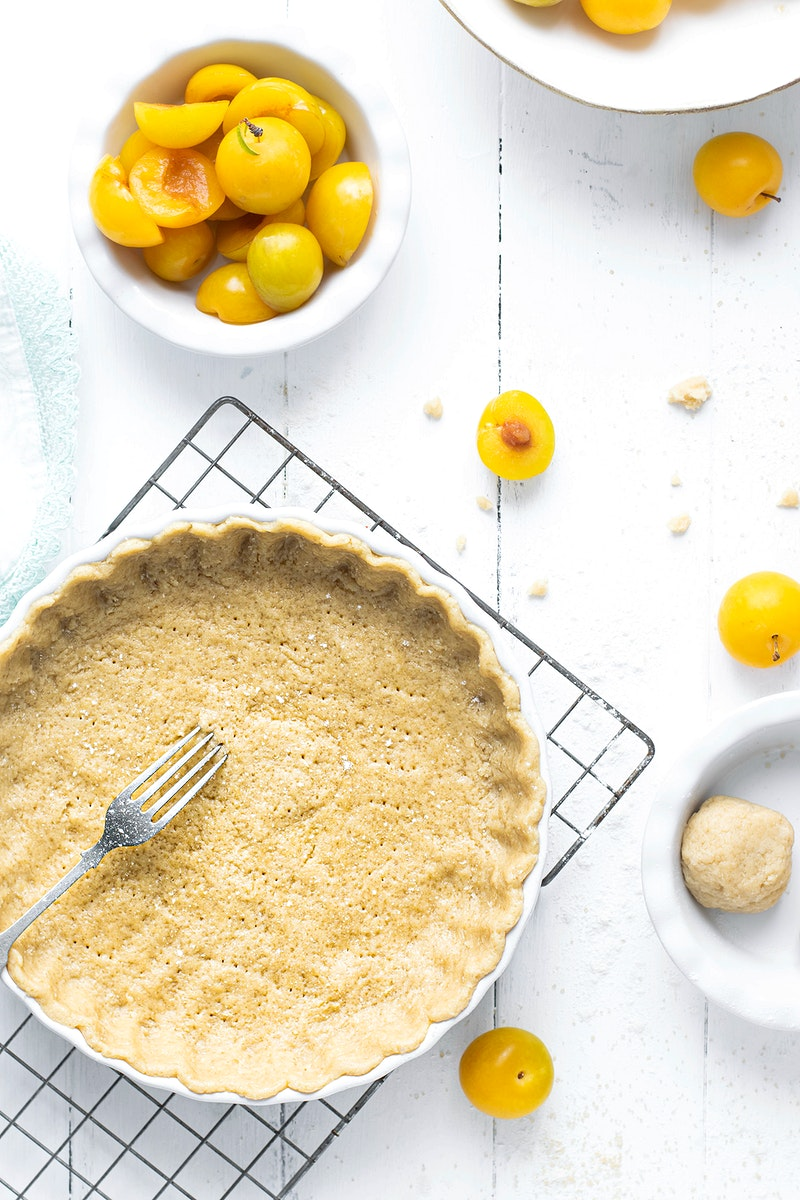 Mirabelle plums by a pie crust