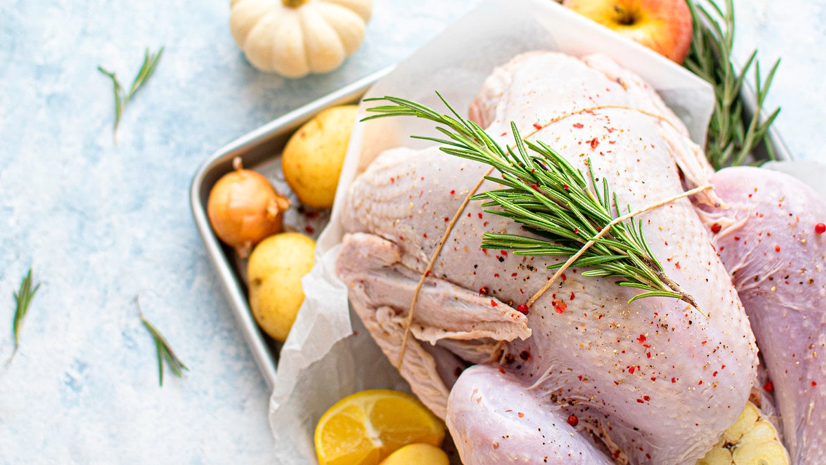 Raw turkey with fresh rosemary
