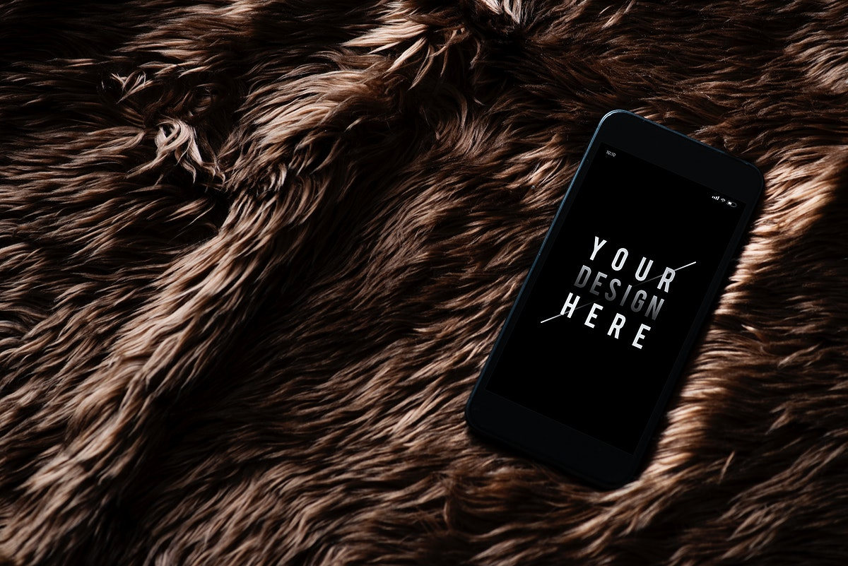 Mobile phone screen mockup on fur surface