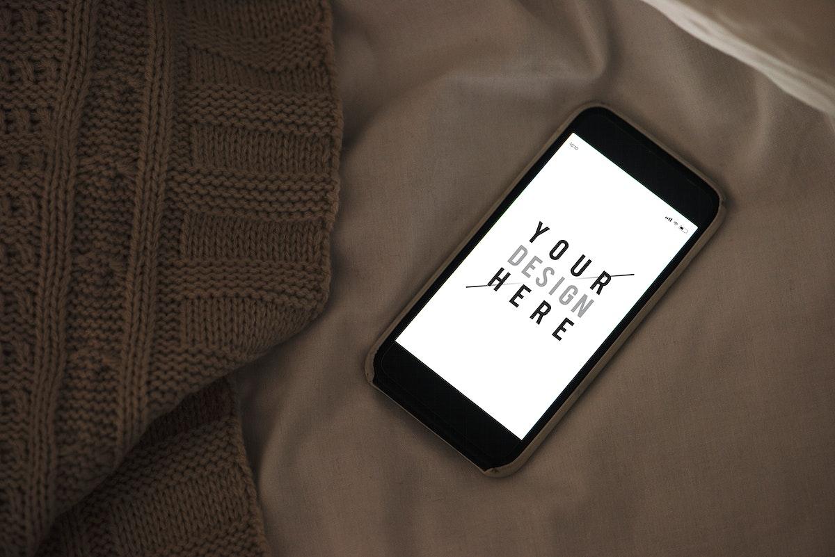 Mobile phone screen mockup on sheet surface
