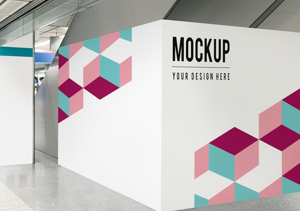 Blank exhibition wall mockup at a train station