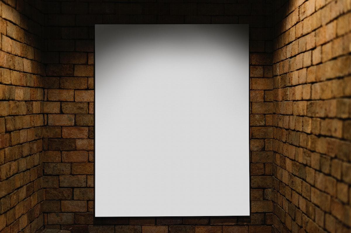 Projector mockup against a brick wall