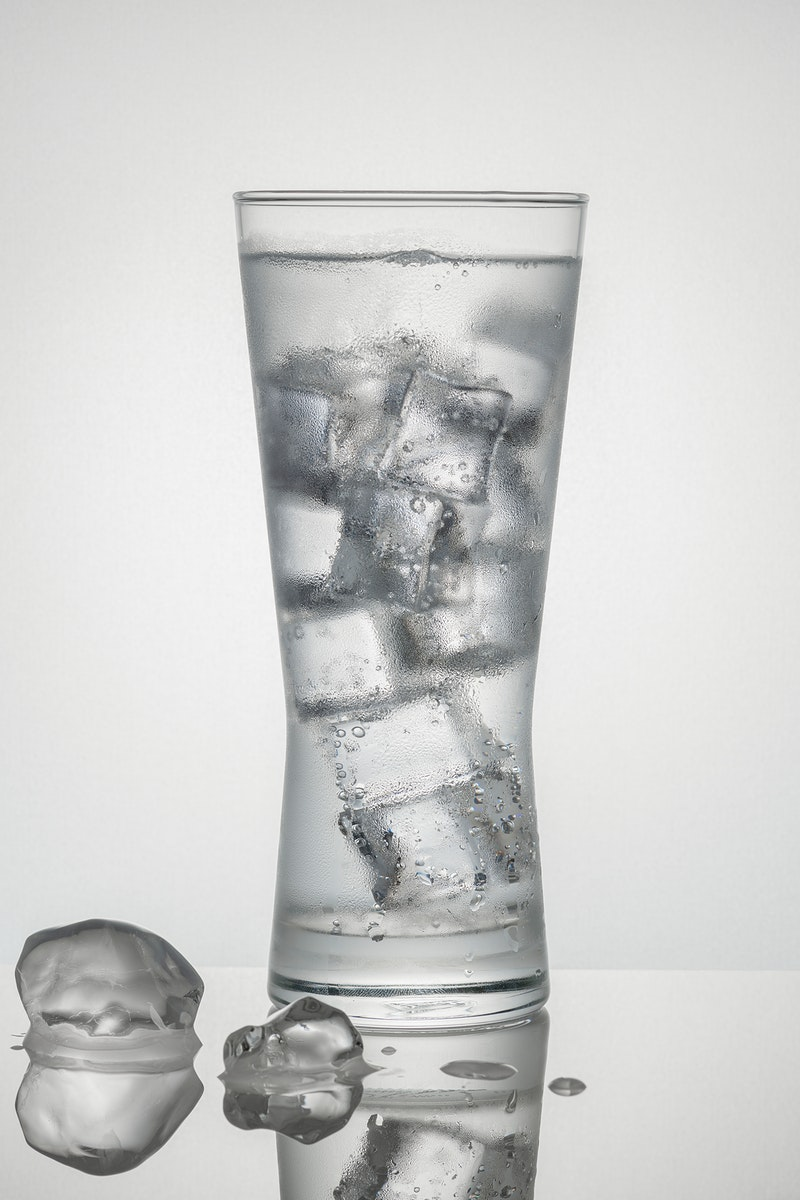 Glass of water with ice macro shot