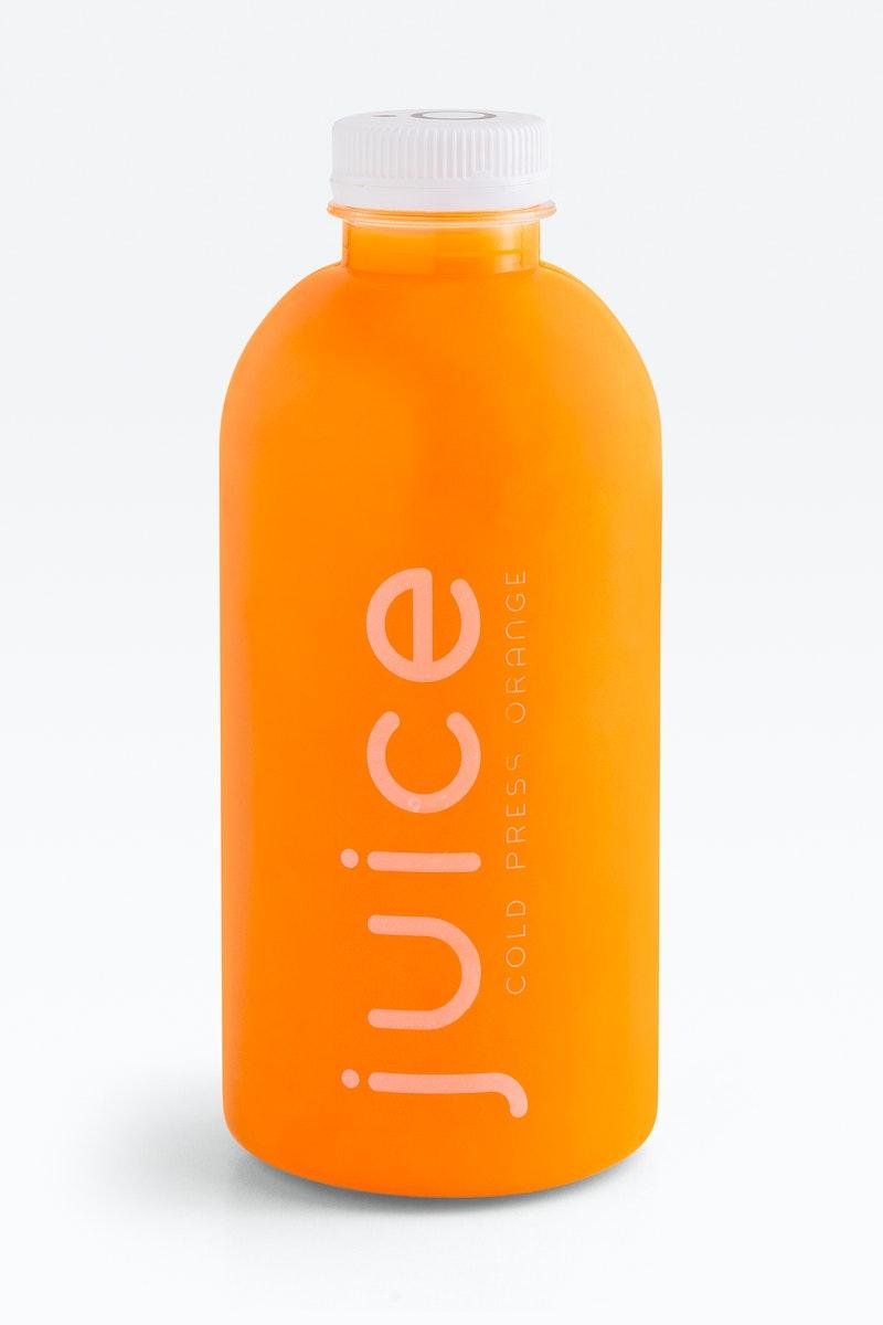 Cold pressed orange juice in a plastic bottle. JANUARY 29, 2020 - BANGKOK, THAILAND