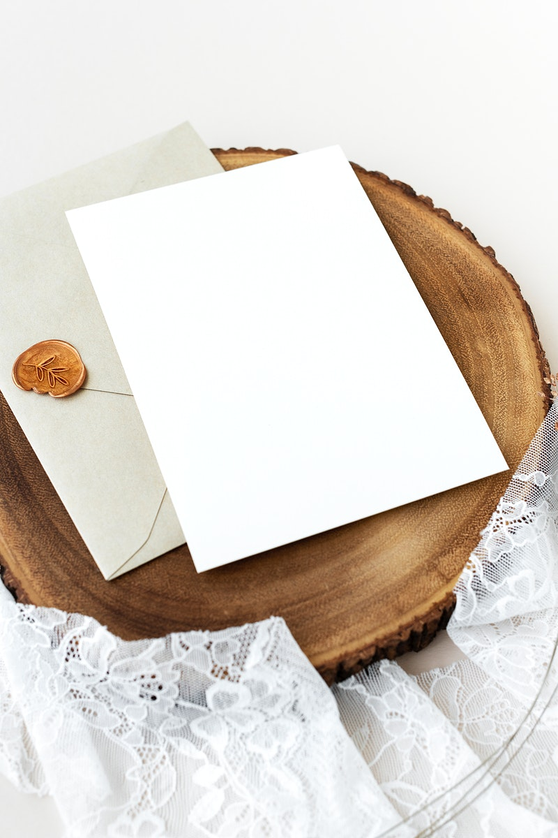 Blank white card on a wooden plate