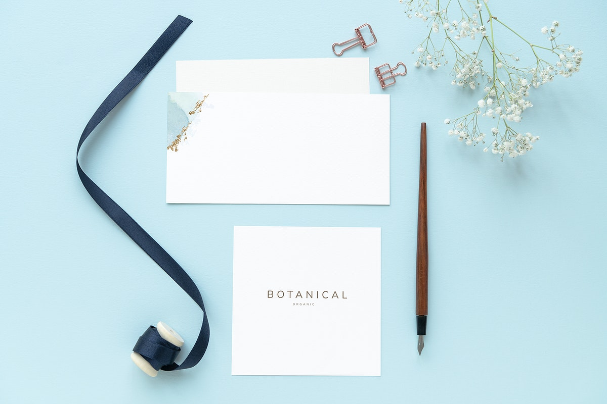 Floral paper notes template mockup on a blue background
