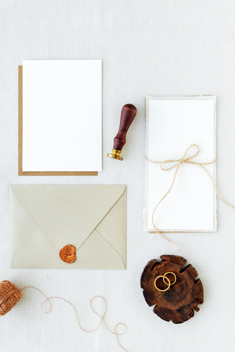 White paper notes and envelope on fabric textured background