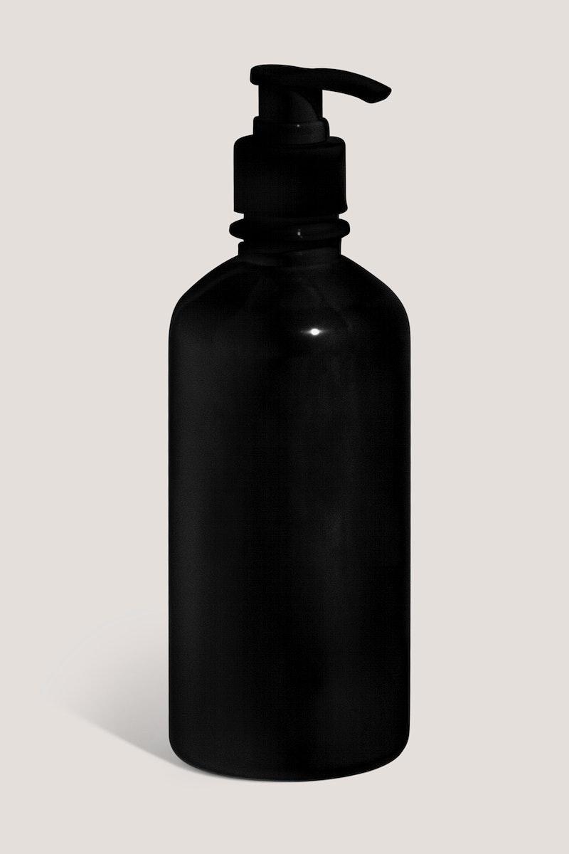 Black skin care bottle mockup design