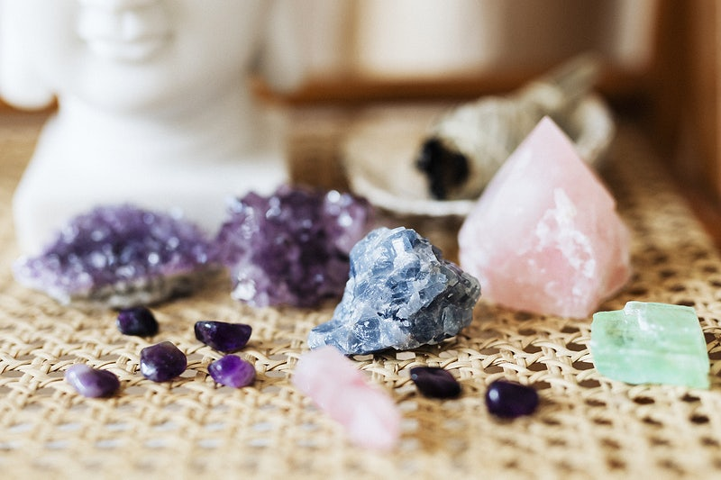 Colorful healing crystals on a wicker surface