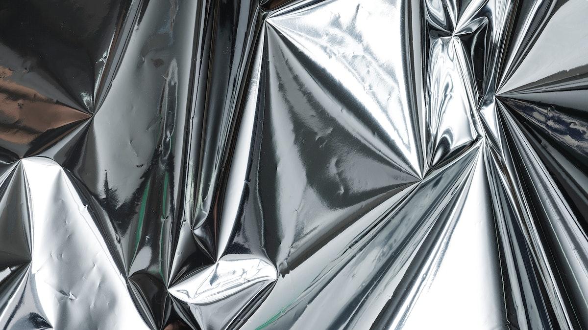 Crumpled aluminum foil textured background