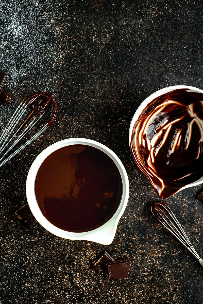 Melted dark chocolate in white small bowl