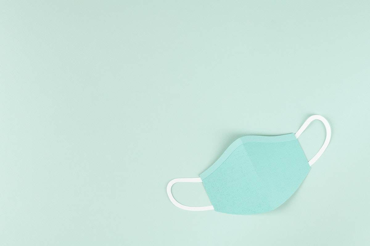 Paper craft surgical mask on a green background illustration