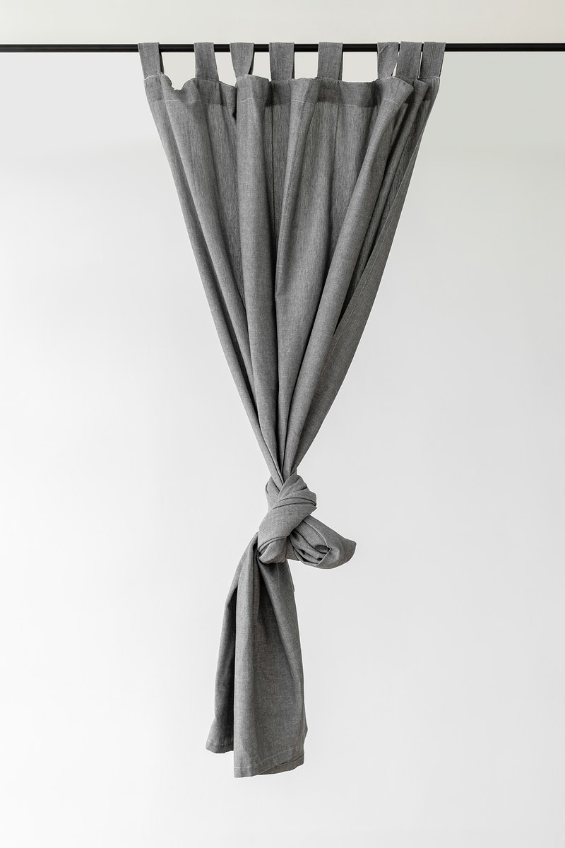 Gray drapery hanging from a curtain rod