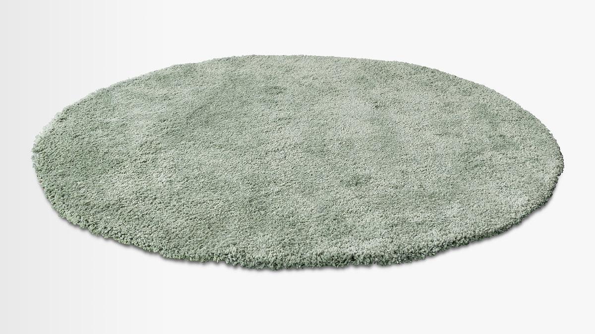 Gray fluffy rounded shape floor carpet