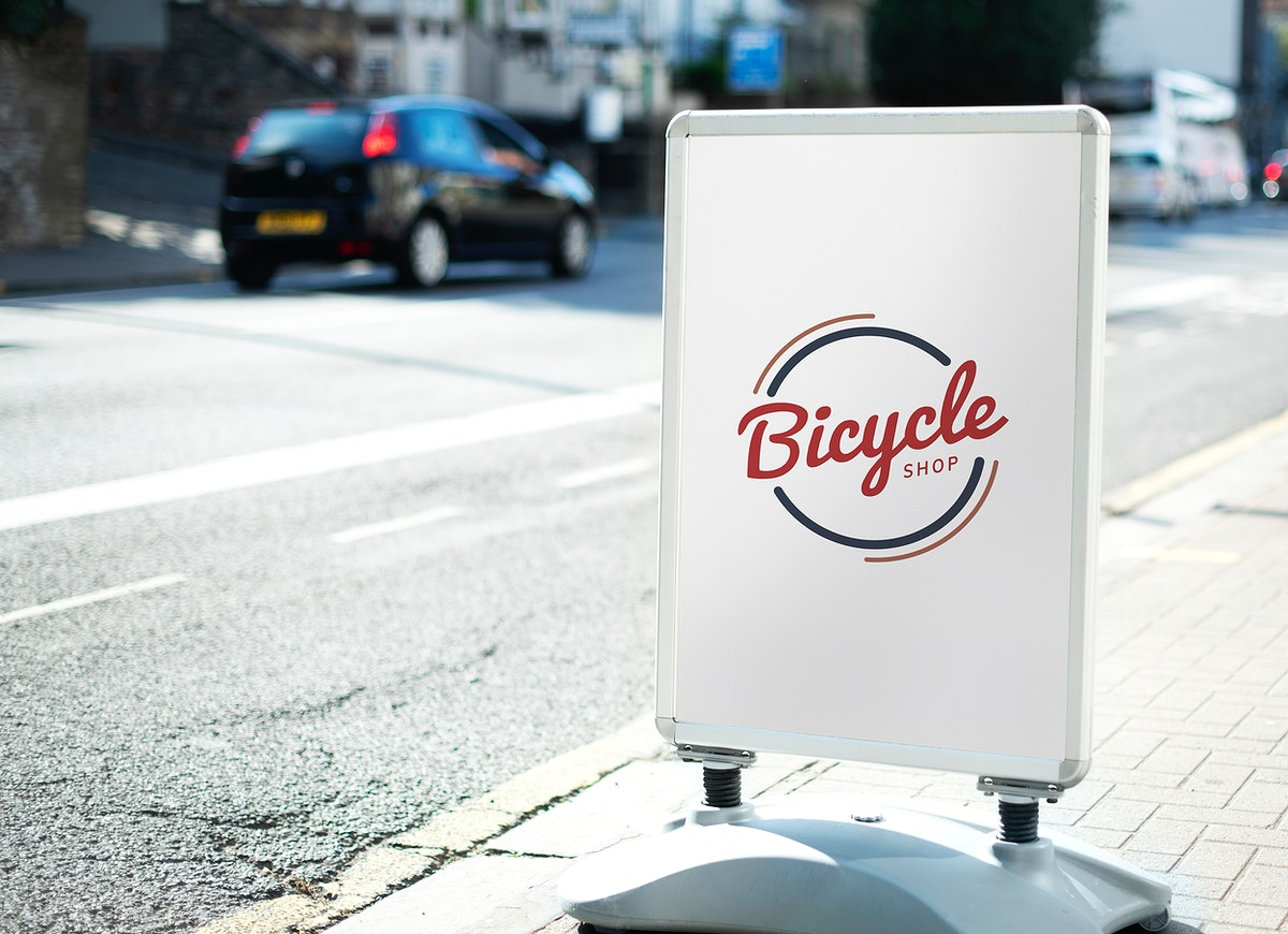 Bicycle shop sign on the street of the city