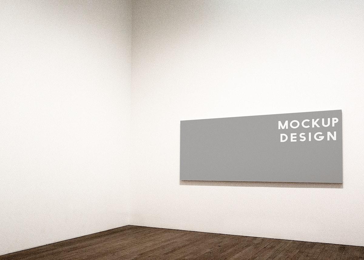 Rectangular frame mockup design on a white wall