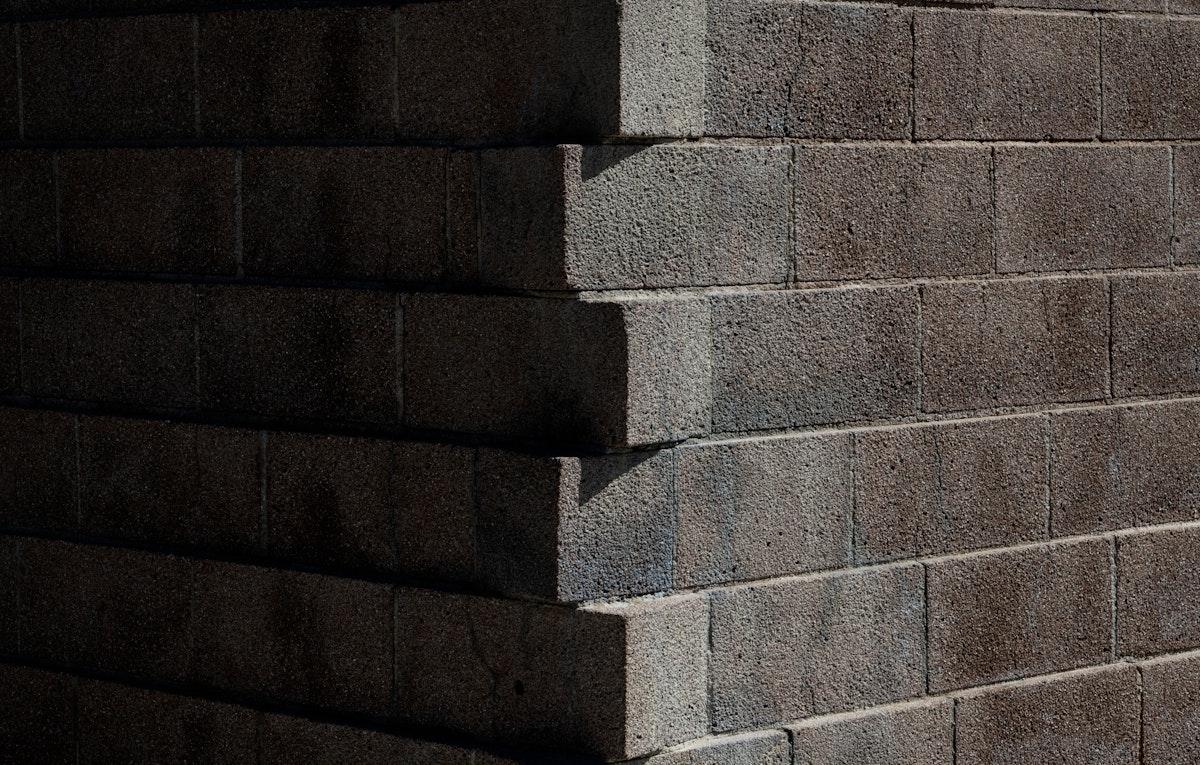 Gray brick wall in a corner