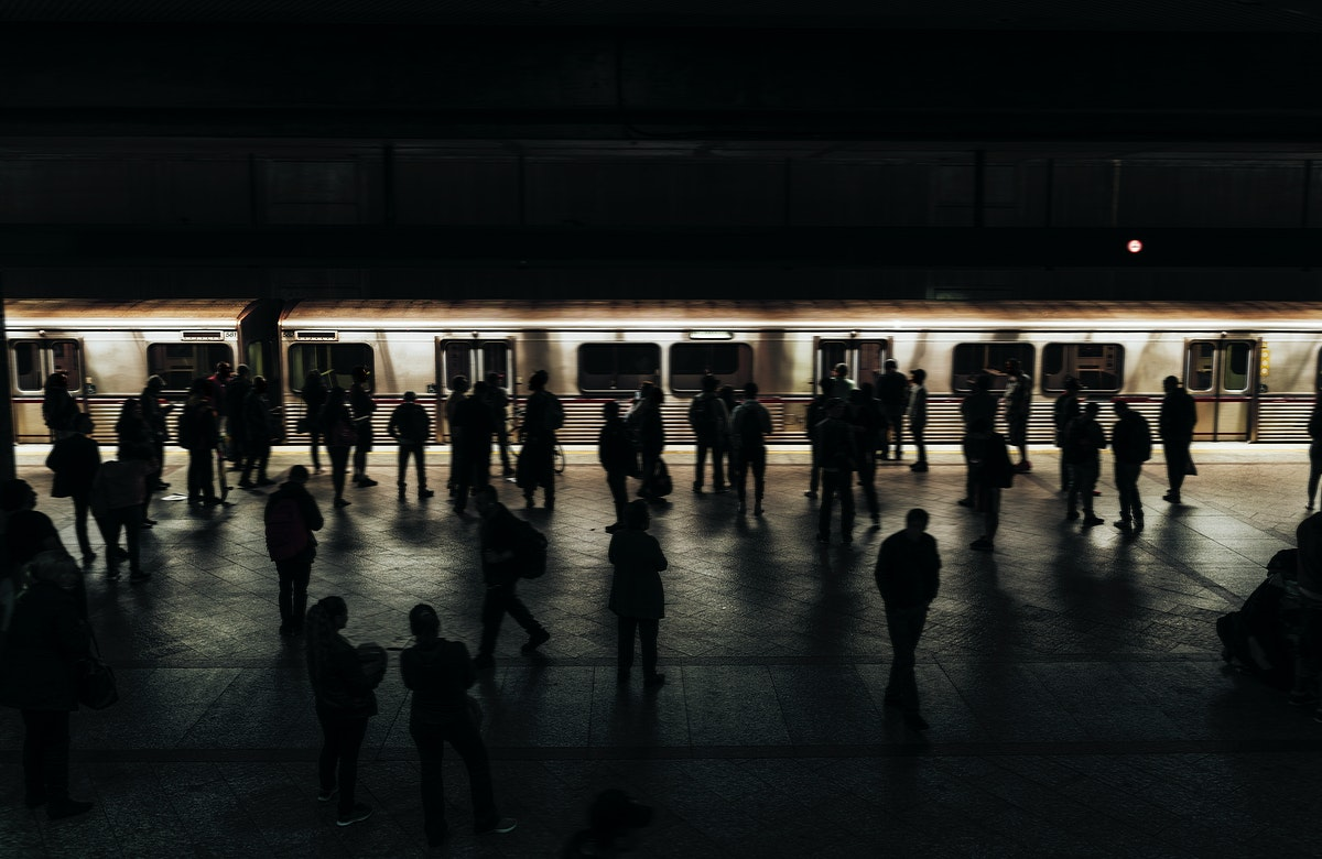 People waiting for a train on a platform