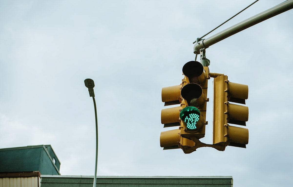 Green traffic light above the intersection