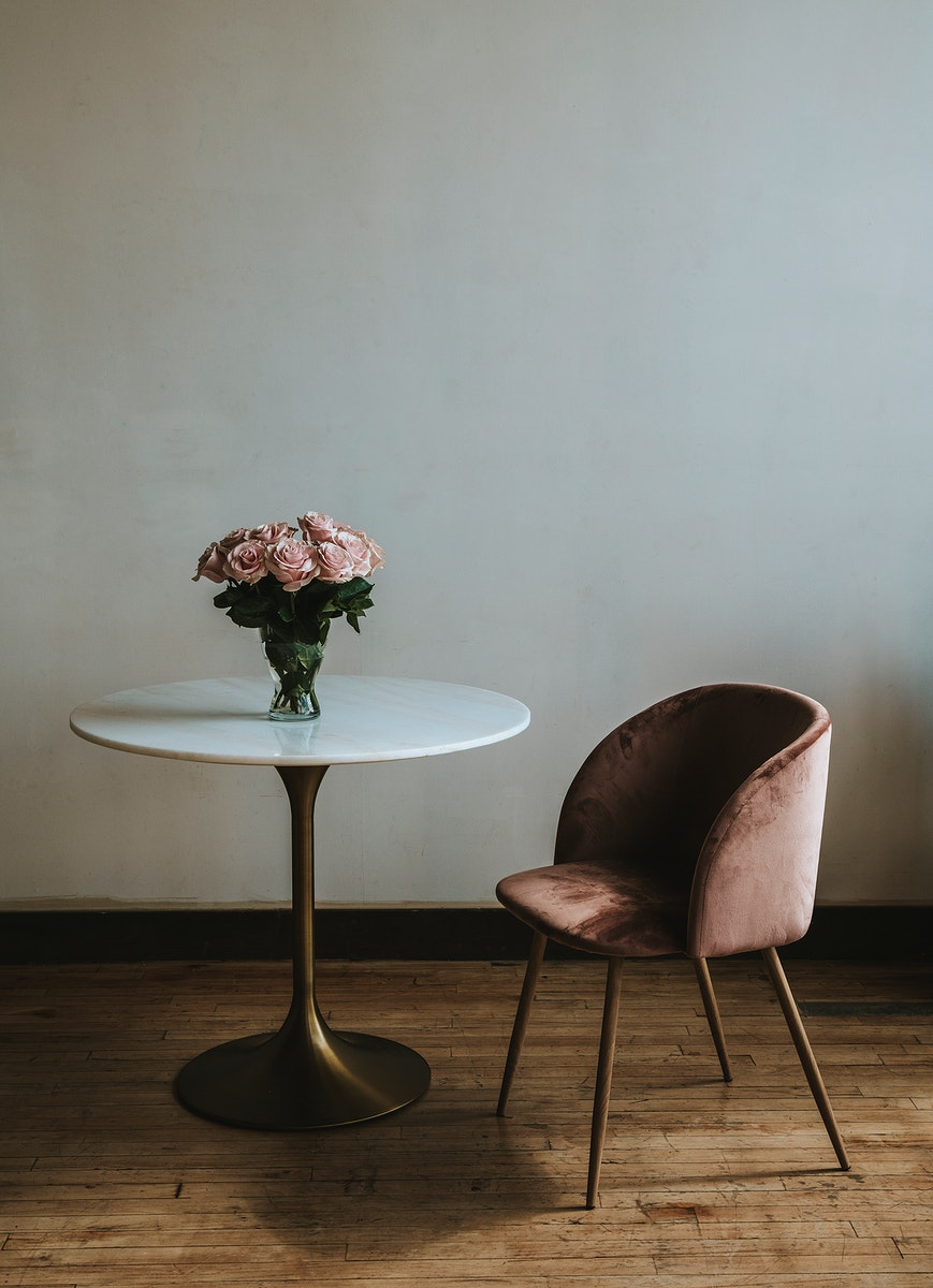 Beautiful pink roses in a vase on a table