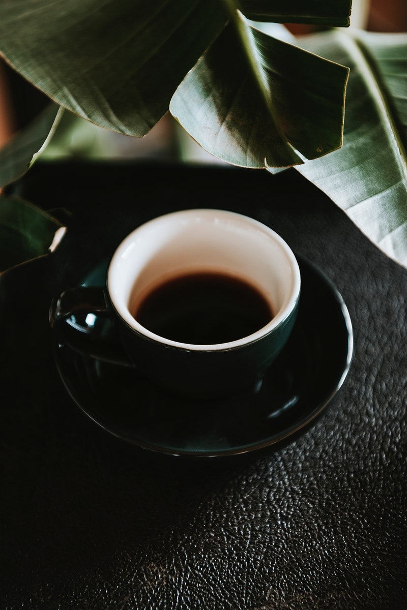 Coffee in a black cup in a cafe