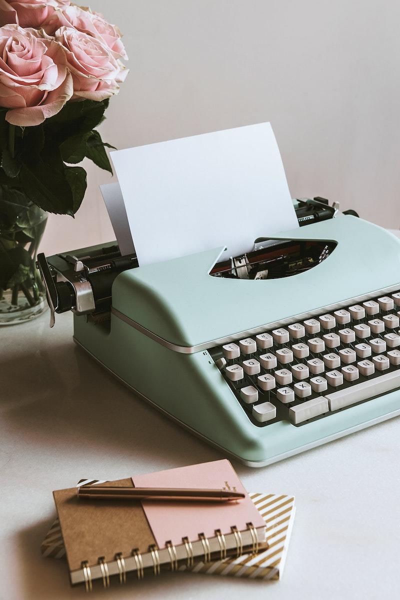 Retro mint typewriter by pink roses