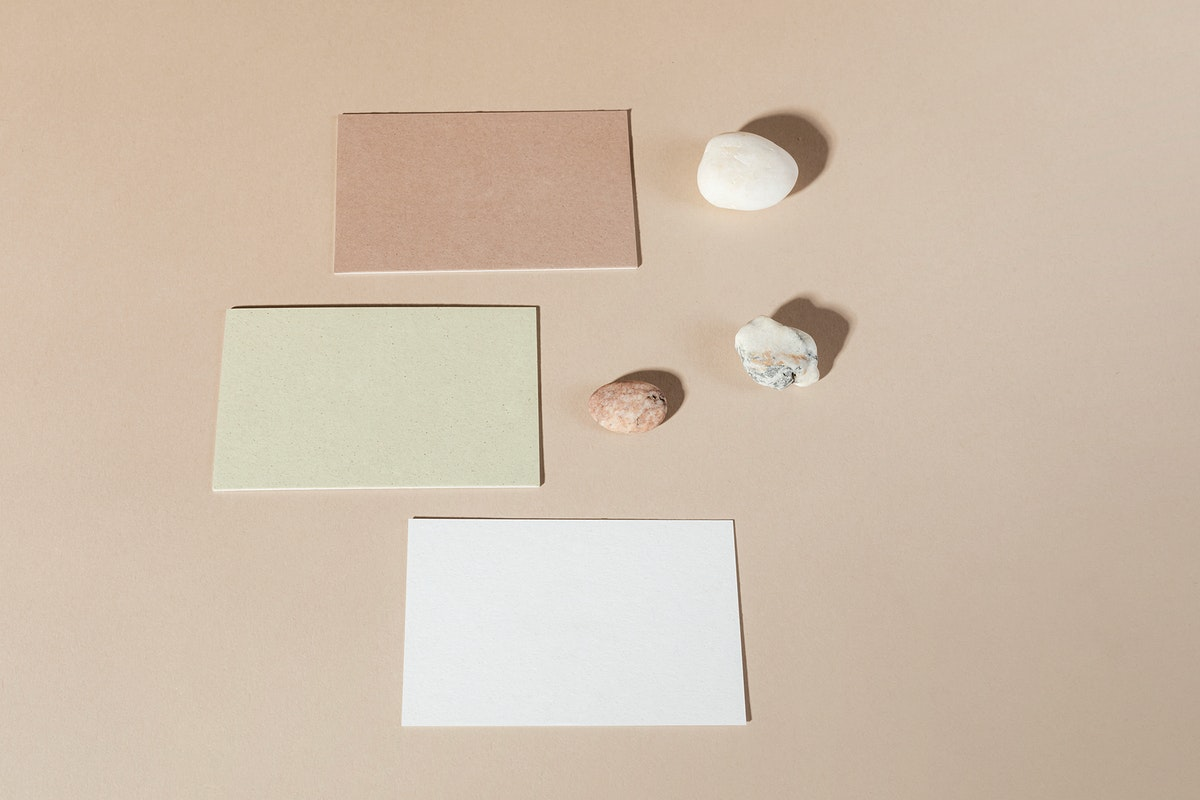 Blank business cards on beige background
