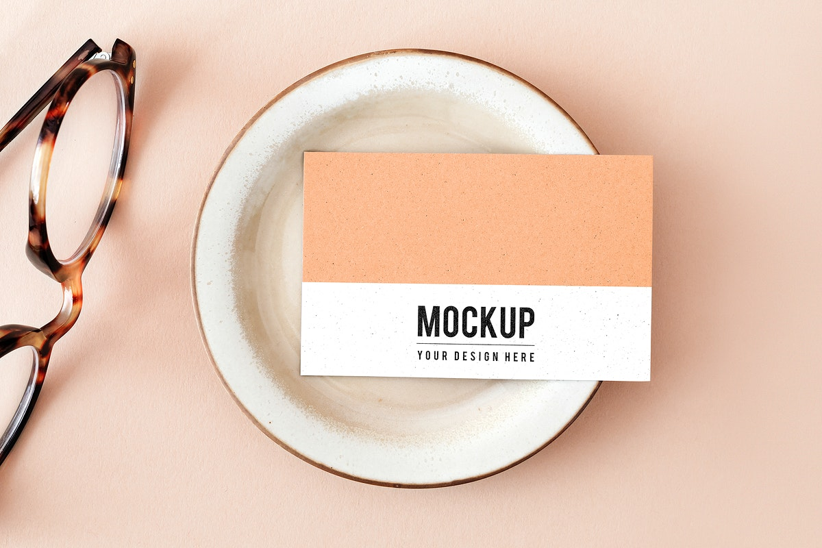 Business card on a plate with glasses mockup