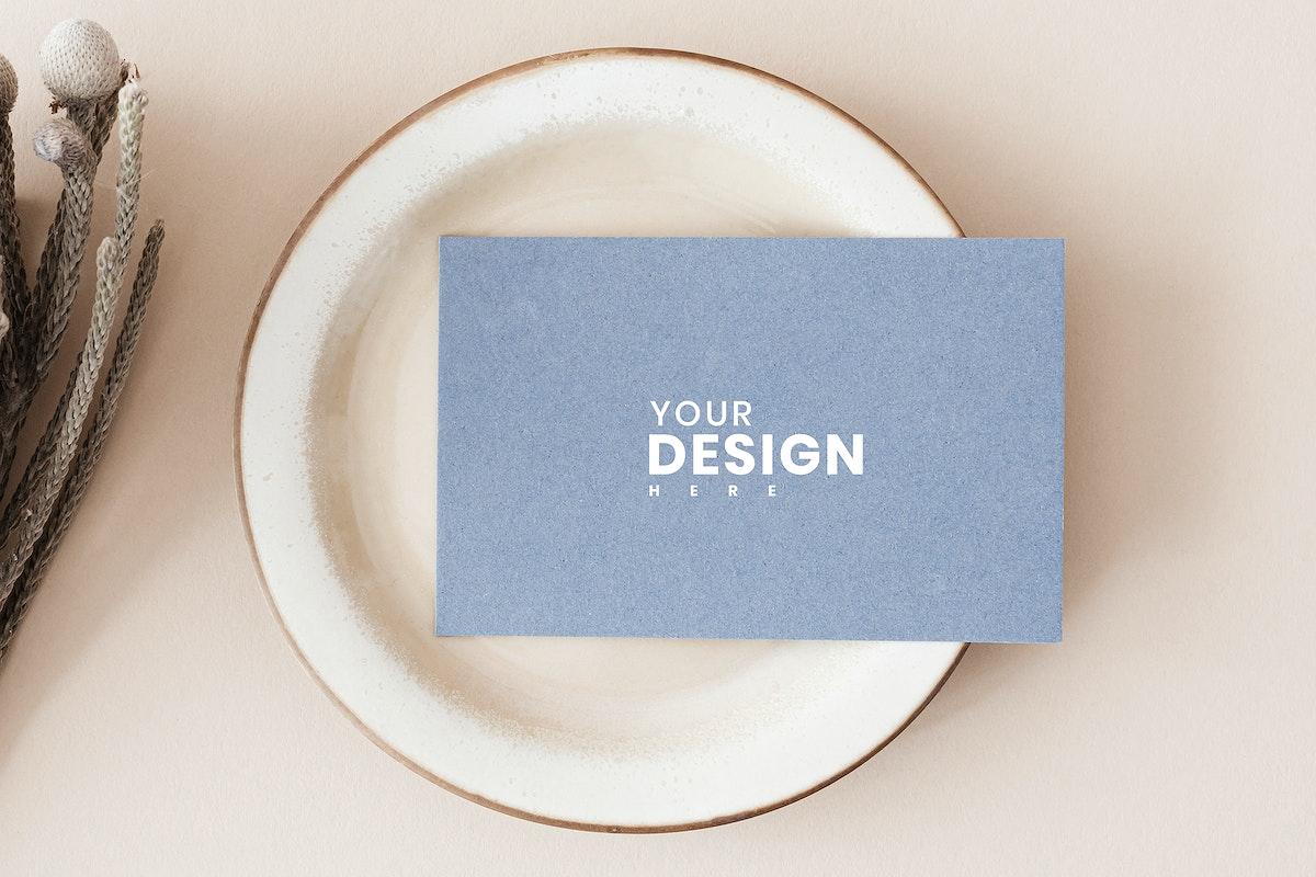 Blue business card on a plate mockup