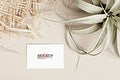Business card decorated with woven and dried grass mockup