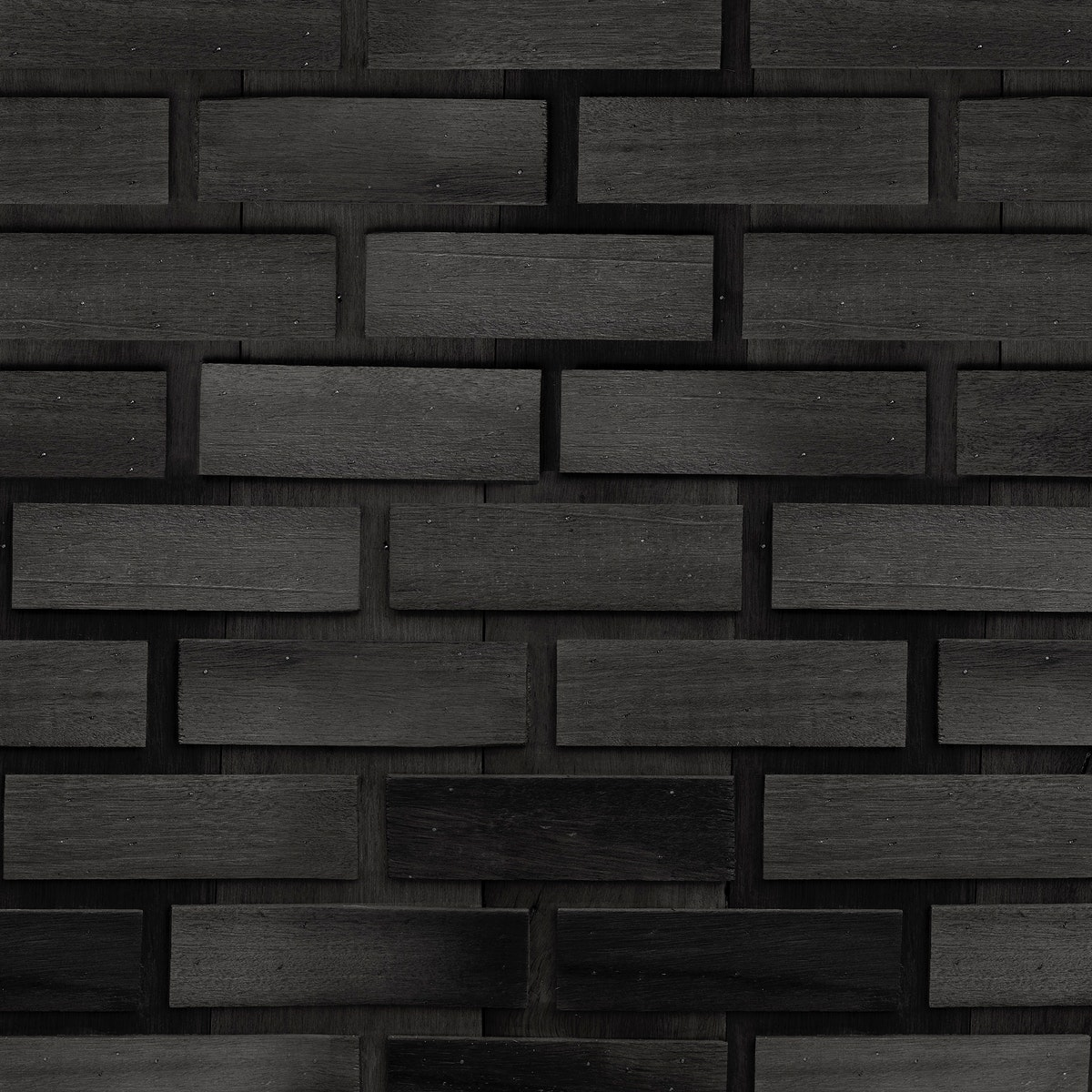 Gray concrete brick wall patterned background
