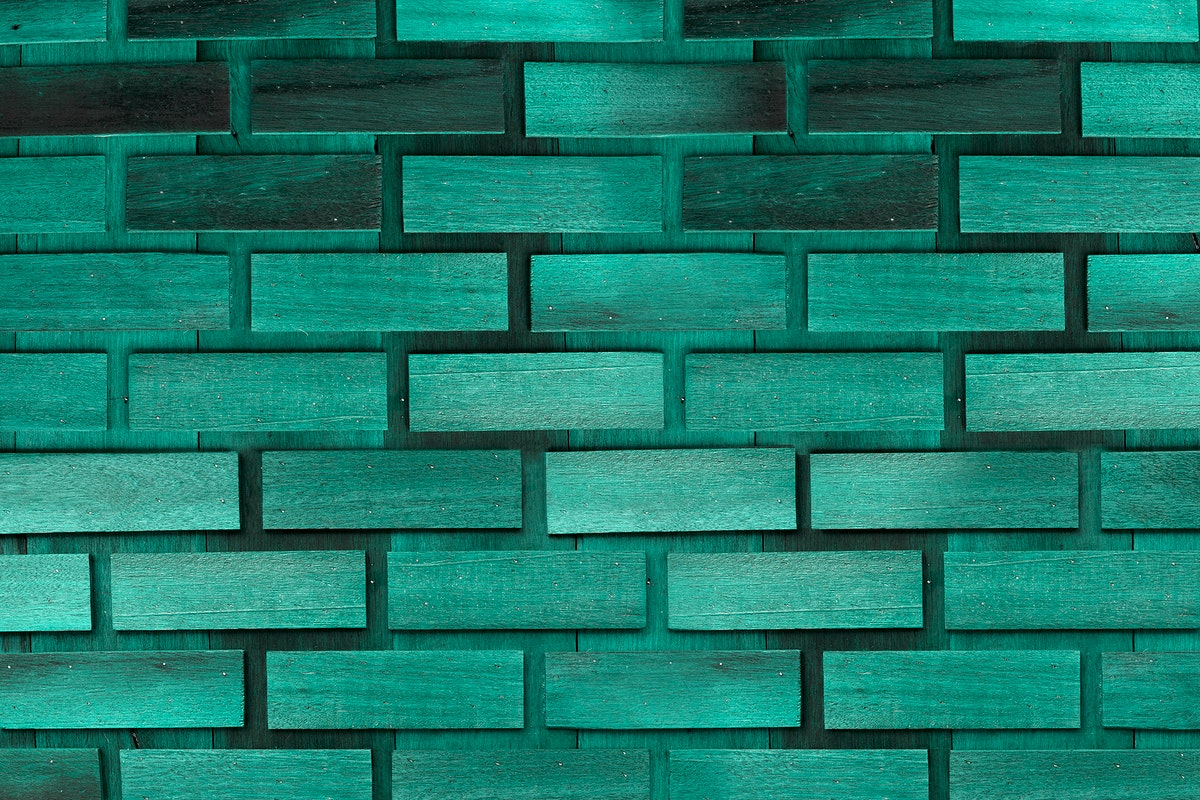 Green concrete brick wall patterned background