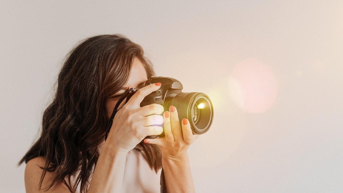 Female photographer taking aphoto