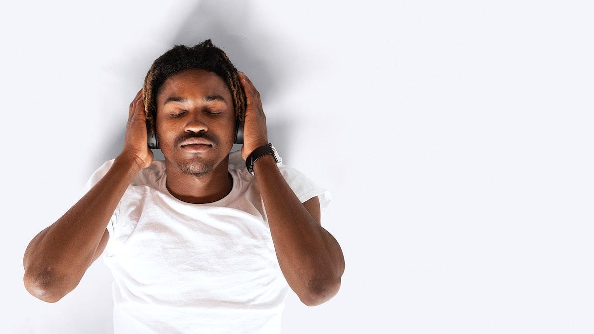 Black man listening to music on his headphones