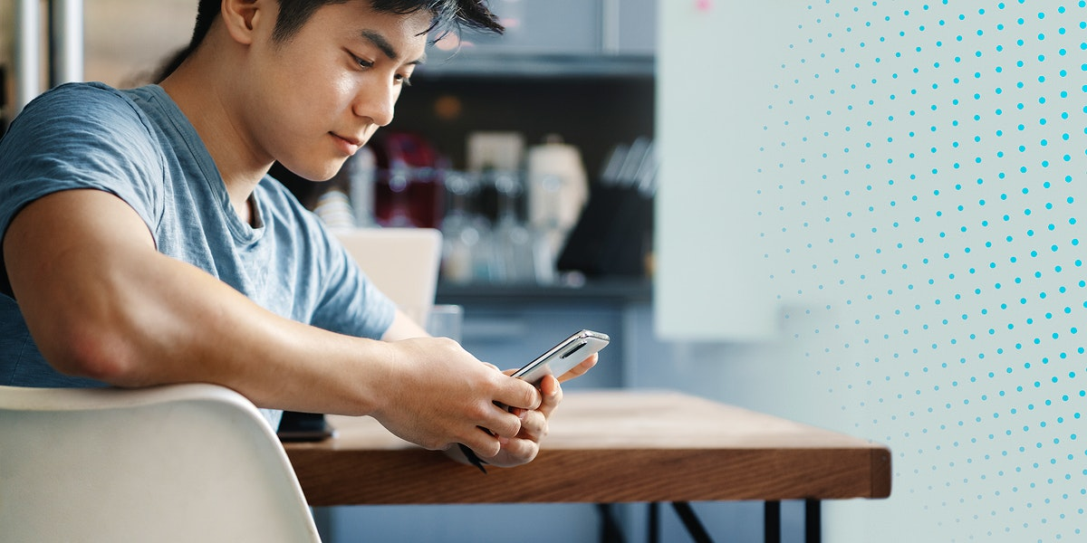 Man using a phone in office canteen mockup social banner