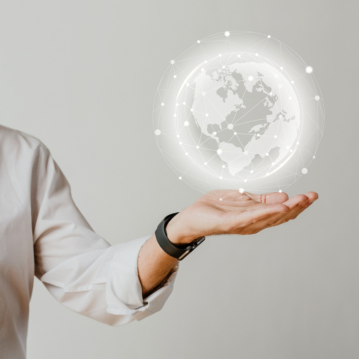 Man presenting a globe in his palm