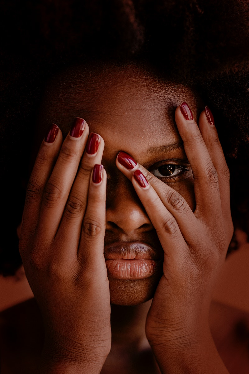Black woman with afro hair covering her face with hands social template