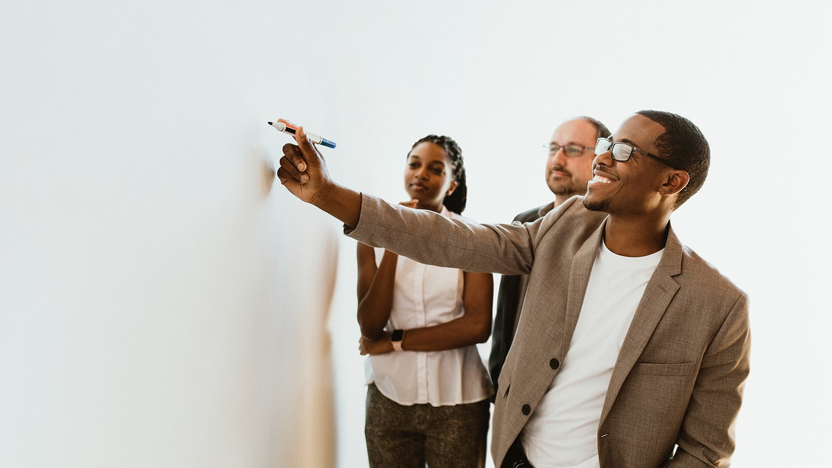 Business people writing on a whiteboard