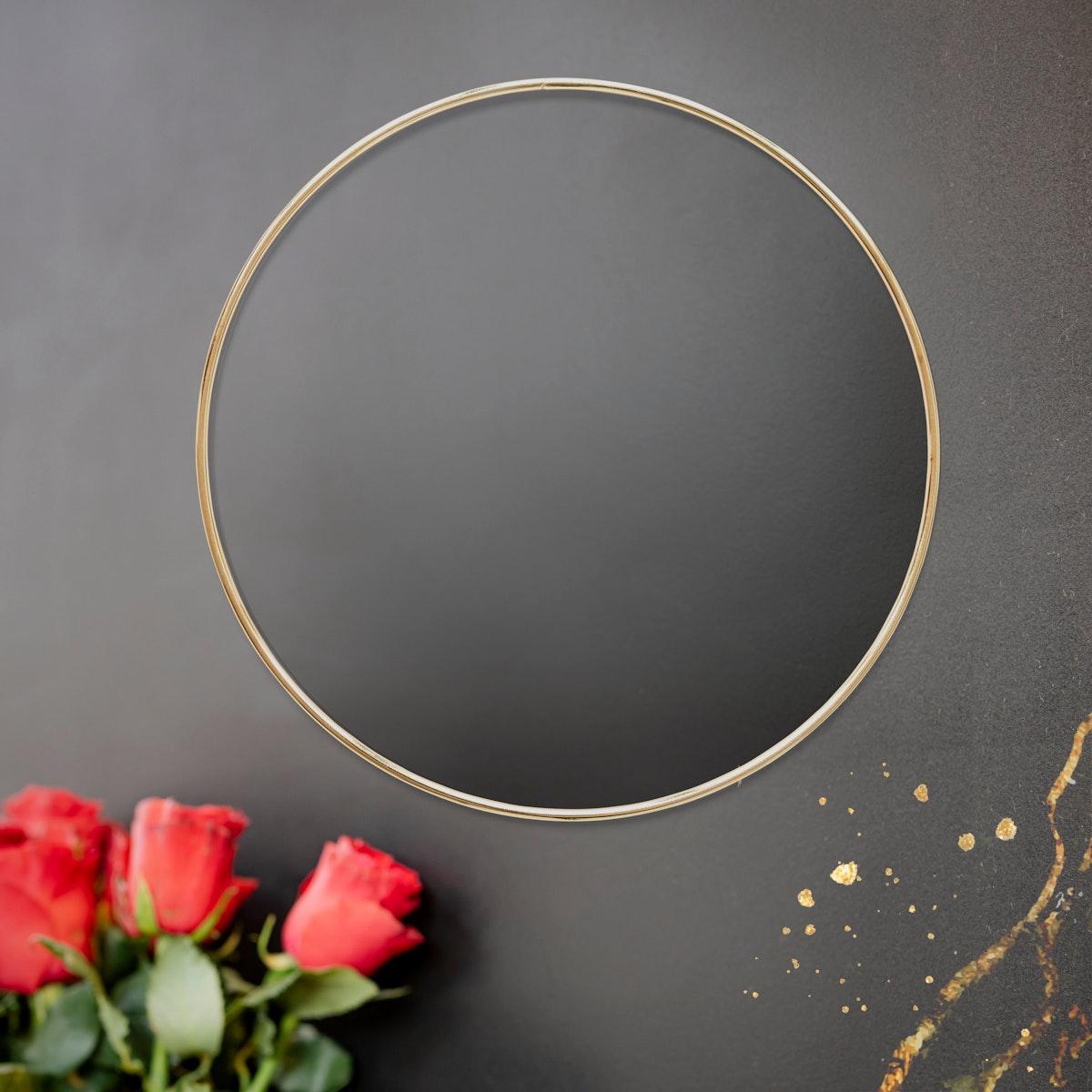 Golden floral frame on a black background