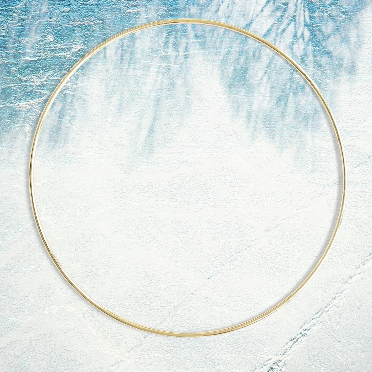 Golden round frame on a leafy shadow background
