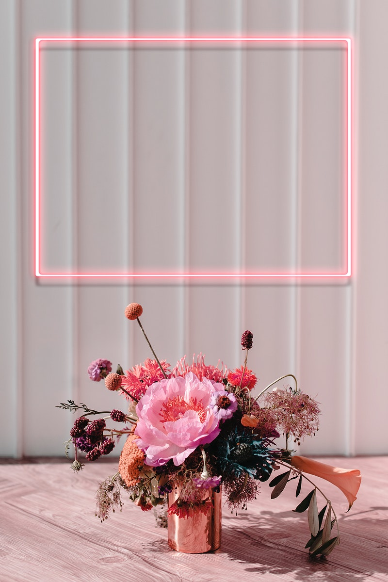 Red floral neon frame on white wall