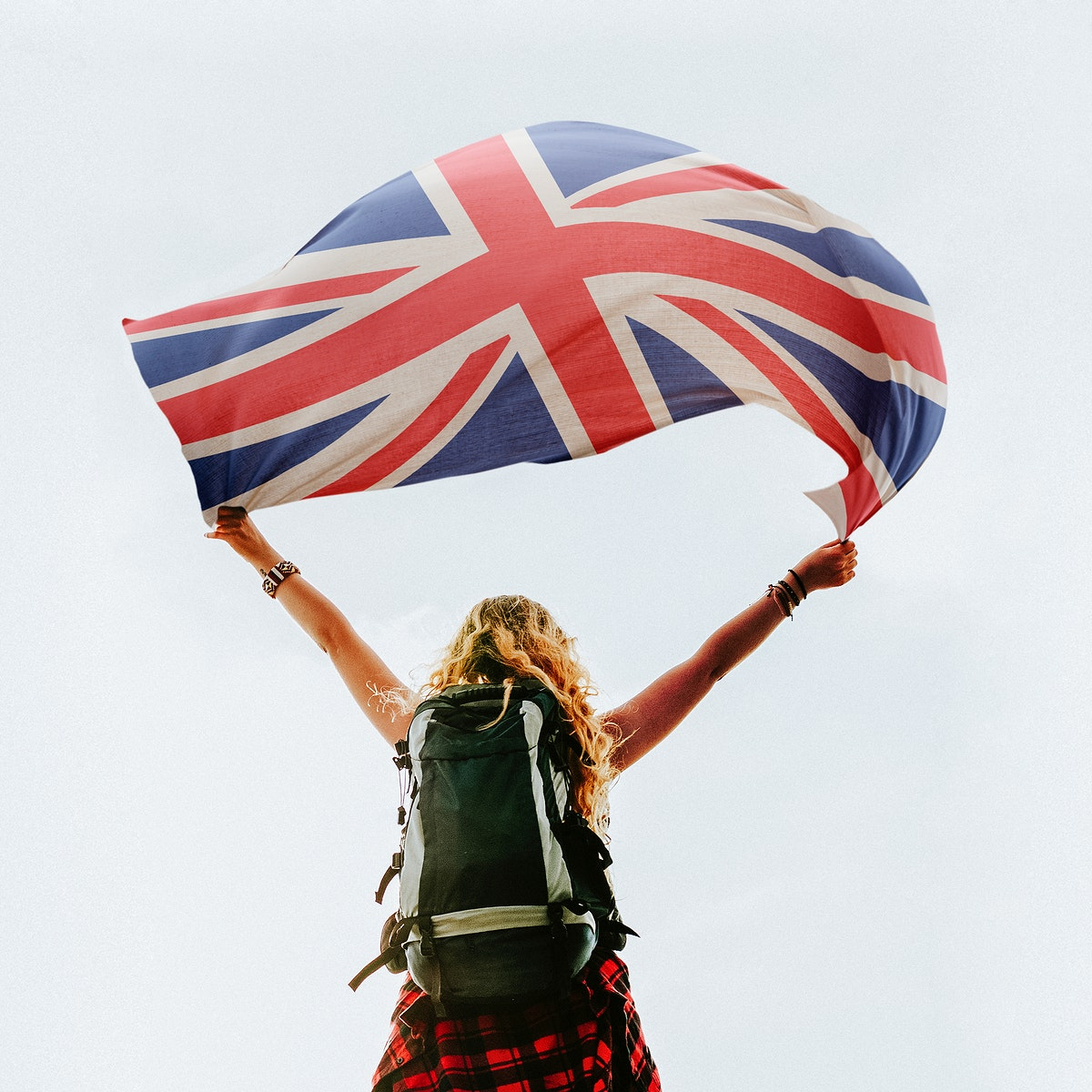 Caucasian woman holding Britain's flag