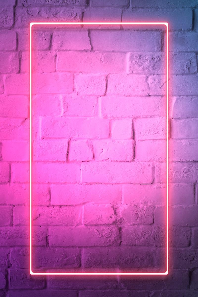 Pink neon lights frame on a white brick wall mockup