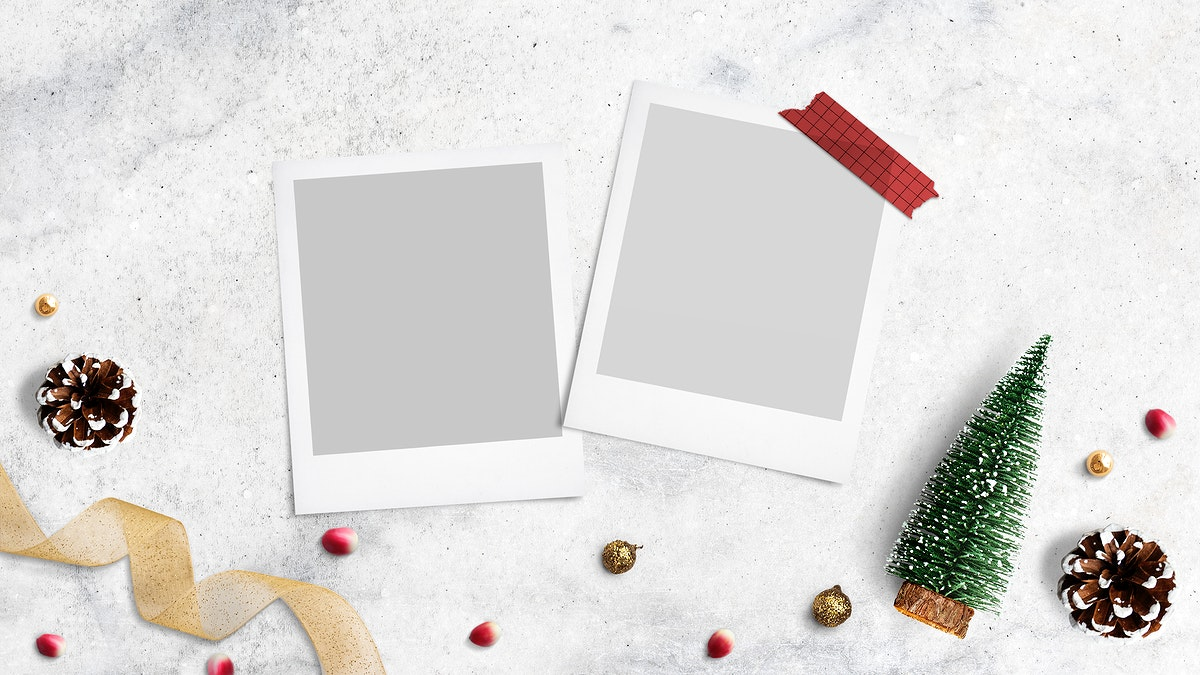 Blank photo frames mockup with Christmas decorations on cream background