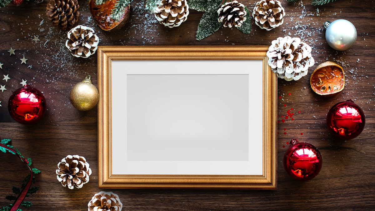 Classic gold frame mockup with Christmas decorations on wooden background