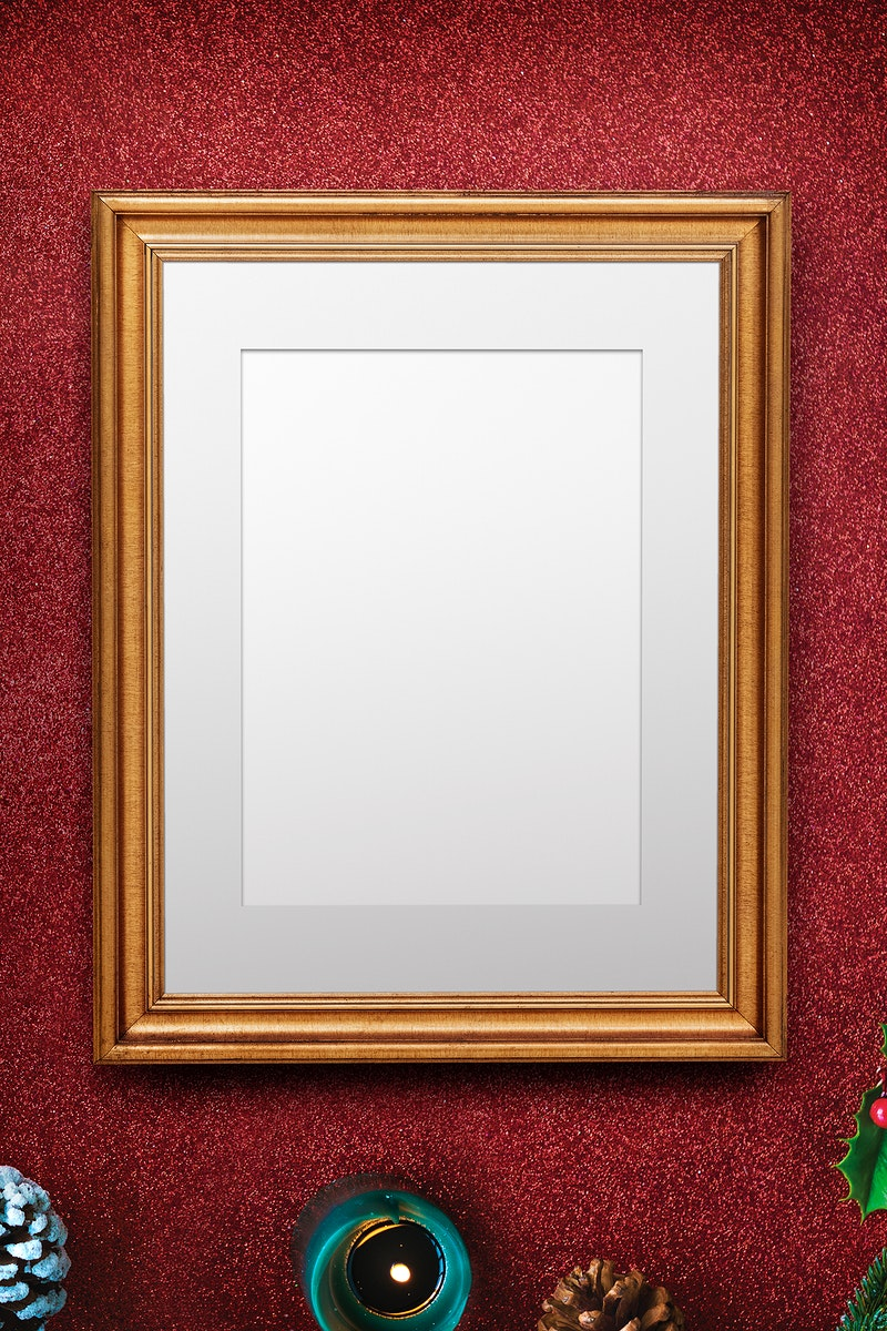 Classic gold frame mockup with Christmas decorations on red background