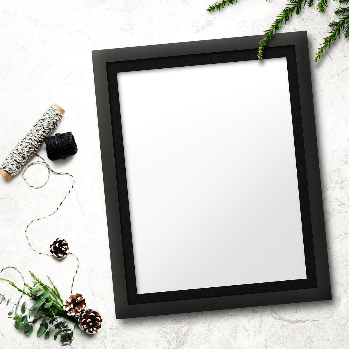 Frame mockup with Christmas decorations on stained background